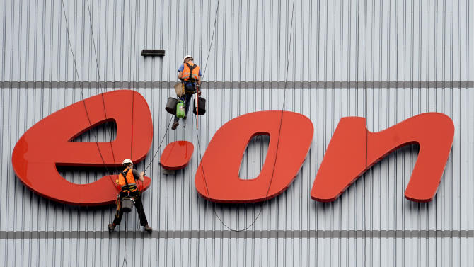 FILE - In this Aug. 3, 2011 file picture workers clean the company's logo at a building of E.On in Datteln, western Germany. Earnings for German utility E.ON rose sharply in the first half of 2012, boosted by a 23 percent increase in sales despite Germany's move away from nuclear power, the company reported Monday, Aug. 13, 2012, as it reiterated its full-year outlook. First half net income attributable to shareholders rose to euro2.9 billion during the period, up from euro691 million last year. (AP Photo/dapd/ Volker Hartmann. File)