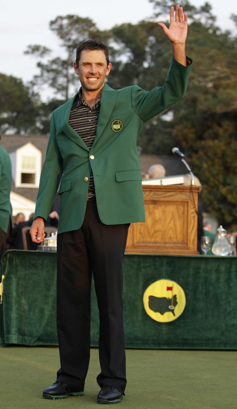 Charl Schwartzel of South Africa waves after winning the Masters championship golf tournament Sunday, April 10, 2011, in Augusta, Ga. (AP Photo/Charlie Riedel)