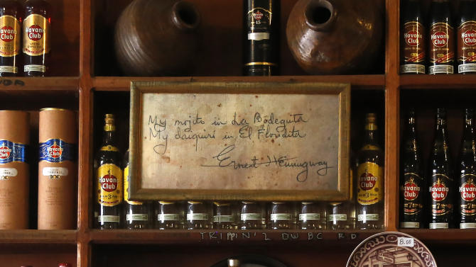 "In this May 24, 2015 photo, a message believed to have been written by late U.S. novelist Ernest Hemingway, hangs framed at the bar inside La Bodeguita del Medio in Old Havana, Cuba. The writing reads: ""My mojito in La Bodeguita, my daiquiri in El Floridita."" (AP Photo/Desmond Boylan)"