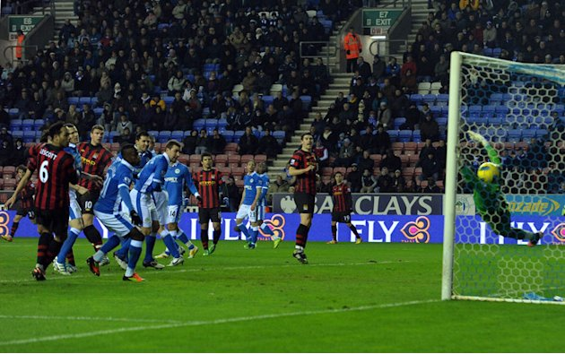 Manchester City's Edin Dzeko (3rdL) Scores Against Wigan Athletics  RESTRICTED TO EDITORIAL USE. No Use With AFP/Getty Images