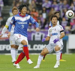 In this Oct. 31, 2010 photo, then Yokohama F Marinos player Naoki Matsuda, front left, plays during a soccer match in Yokohama, near Tokyo. Former Japan international Matsuda died Thursday, Aug. 4, 2011, two days after suffering a cardiac arrest during training, according to Japanese news agency Kyodo. He was 34. (AP Photo/Kyodo News) JAPAN OUT, MANDATORY CREDIT, NO LICENSING IN CHINA, FRANCE, HONG KONG, JAPAN AND SOUTH KOREA