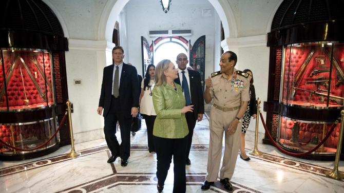 Field Marshal Hussein Tantawi walks with US Secretary of State Hillary Rodham Clinton to a meeting at the Ministry of Defense July 15, 2012 in Cairo, Egypt. Clinton is holding talks with Egypt's top military leaders to press for the military to work with Egypt's new Islamist leaders on a full transition to civilian rule. (AP Photo/Brendan Smialowski, Pool)