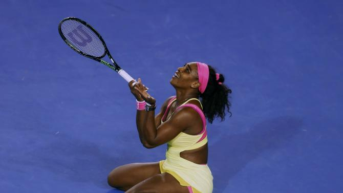 Williams of the U.S. reacts after winning a point against Sharapova of Russia during their women's singles final match at the Australian Open 2015 tennis tournament in Melbourne