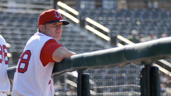 In this June 15, 2012, photo provided by the Lowell Spinners, Boston Red Sox draft pick Kyle Kraus stands at the team's stadium in Lowell, Mass. Kraus was taken by the Boston Red Sox with the 241st pick overall, and received a $1,000 signing bonus. Signing bonuses have plunged for many top picks in this year's amateur draft, the first under restrictive rules adopted in baseball's new collective bargaining agreement. Teams face penalties if they exceed specified totals for their bonuses. As a result, some clubs selected players they knew they could sign for close to nothing. (AP Photo/Lowell Spinners, Casey Gariepy)