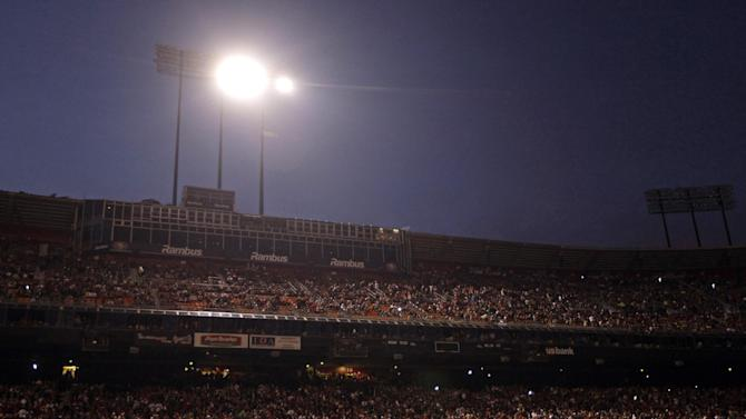 Fans and officials wait at Candlestick Park during a power outage before an NFL football game between the San Francisco 49ers and the Pittsburgh Steelers in San Francisco, Monday, Dec. 19, 2011. (AP Photo/Marcio Jose Sanchez)