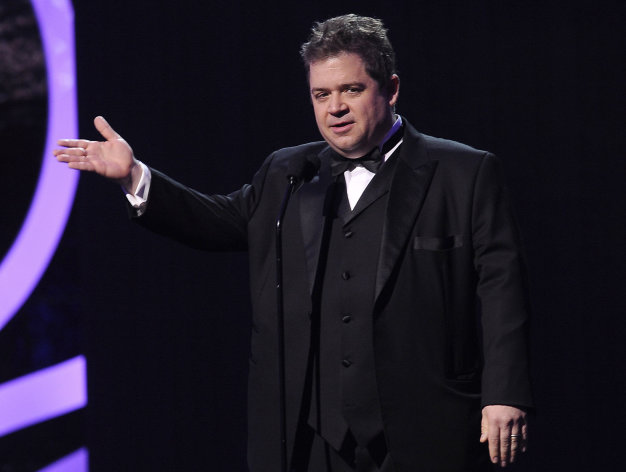 FILE - In this Jan. 12, 2012 file photo, actor-comedian Patton Oswalt is seen onstage during the 17th Annual Critics' Choice Movie Awards in Los Angeles. Oswalt will host the 16th annual Webby Awards where winners are famously restricted to five-word acceptance speeches. The awards will be held at the Hammerstein Ballroom in New York City on May 21 and streamed live on WebbyAwards.com. (AP Photo/Chris Pizzello, File)