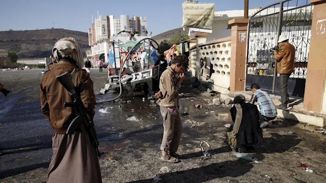 A Houthi militant stands outside al-Nour mosque in Yemen's capital Sanaa