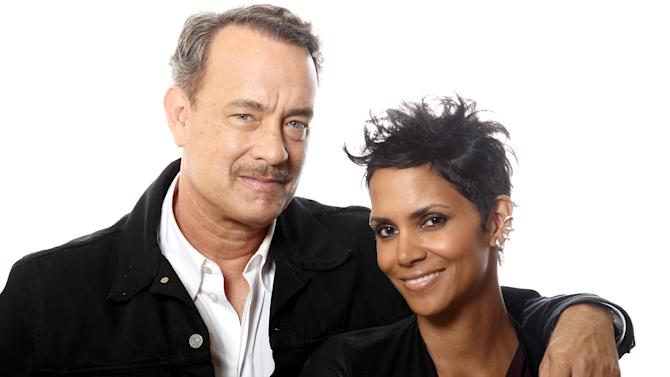 "In this Oct. 14, 2012 photo, actors Tom Hanks, left, and Halle Berry, from the upcoming film ""Cloud Atlas,"" pose for a portrait in Beverly Hills, Calif. The stars of ""Cloud Atlas,"" along with British author David Mitchell, who wrote the novel that inspired the genre-bending epic about souls returning and intertwining over the centuries, shared their beliefs and disbeliefs about reincarnation as the film heads to U.S. theaters Oct. 26, 2012. Hanks himself doesn't buy into reincarnation, while Berry, Whishaw, Mitchell, Sarandon and co-stars Hugo Weaving and Jim Sturgess either believe or at least think it's possible that souls come back for an encore. (Photo by Matt Sayles/Invision/AP)"