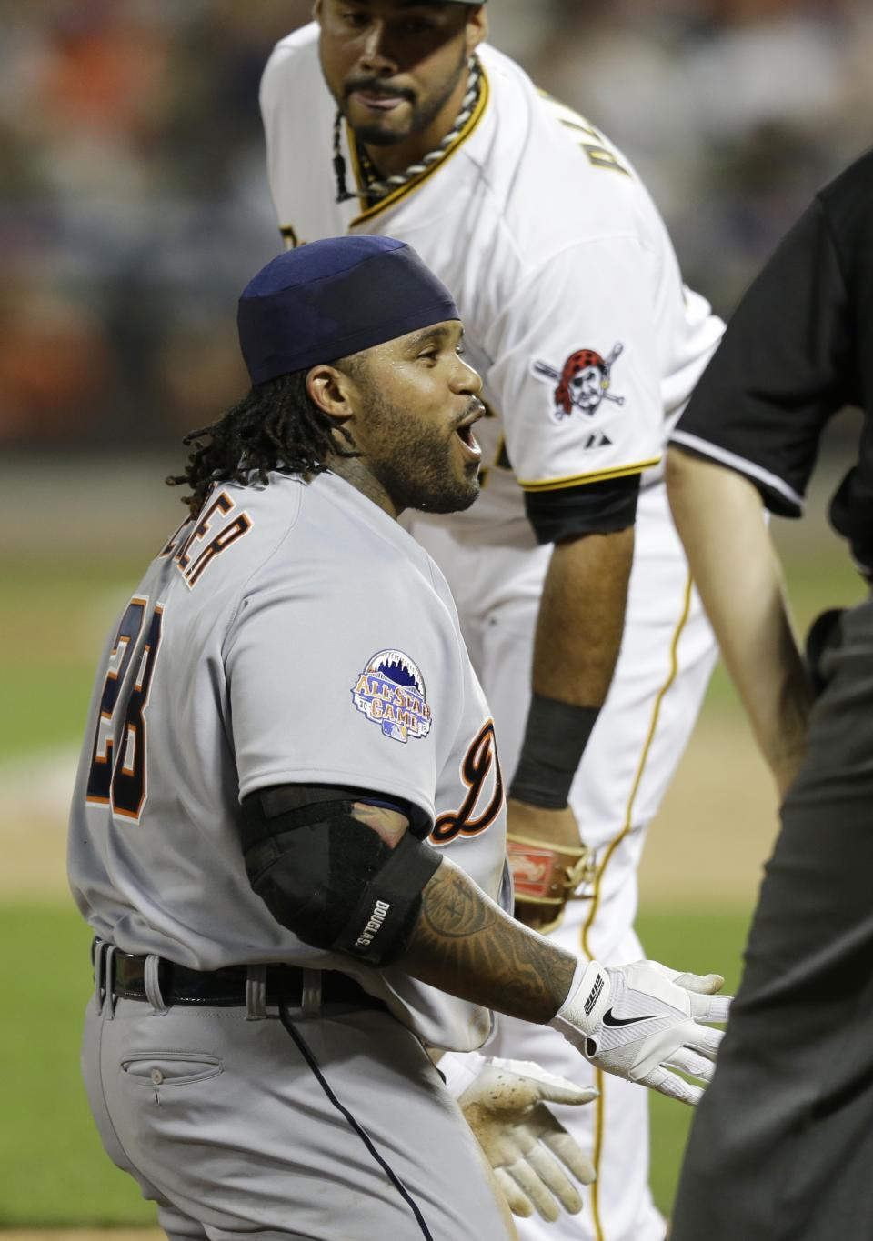 American League's Prince Fielder, of the Detroit Tigers, reacts after sliding into third base on a triple in the ninth inning of the MLB All-Star baseball game, on Tuesday, July 16, 2013, in New York. Behind is National League's Pedro Alvarez, of the Pittsburgh Pirates. (AP Photo/Kathy Willens)