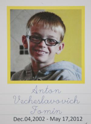 This undated photo provided by the Sinchuk family, and printed on a written obituary, shows Anton Fomin, a 9-year-old Russianboy who was killed in a Nebraska house fire on May 17. Nearly 200 people gathered at a church in Lincoln, Neb.,  on Wednesday to mourn Anton Fomin, who was living with the Sinchuks, who were his legal guardians.  (AP Photo/Nati Harnik)