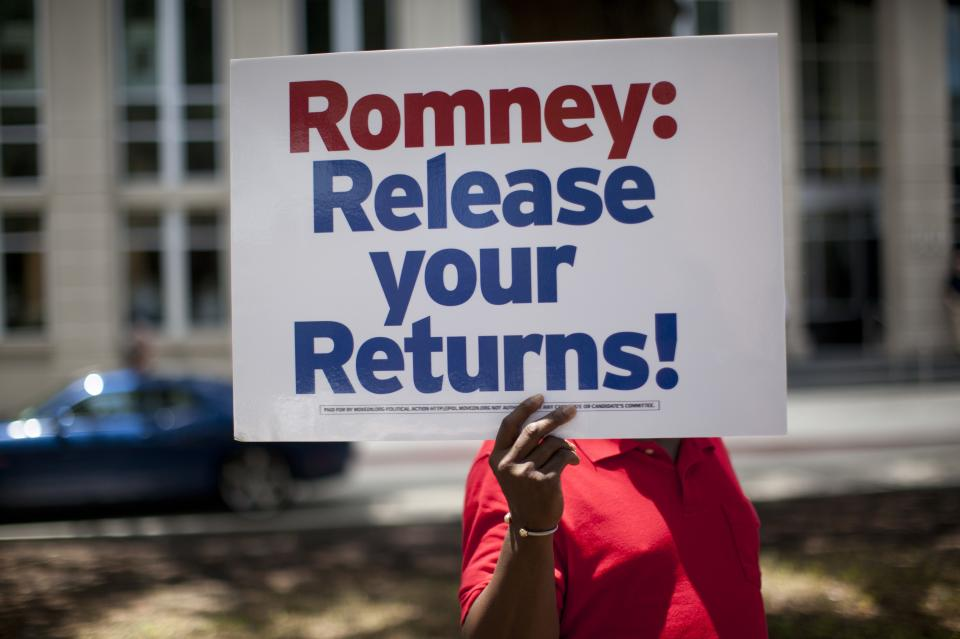 Demonstrators stand outside a fundraiser for Republican presidential candidate, former Massachusetts Gov. Mitt Romney on Monday, July 16, 2012 in Baton Rouge, La.  (AP Photo/Evan Vucci)