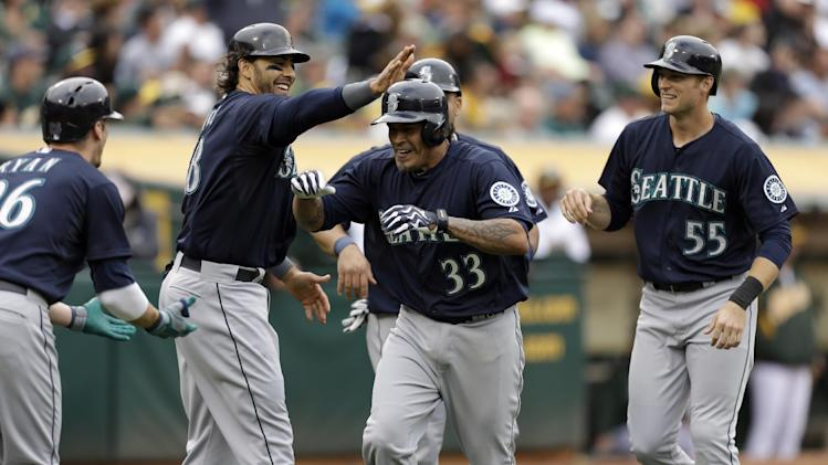 Blanco slam backs Hernandez, Mariners beat A's