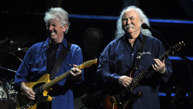 FILE - In this Oct. 2009 file photo, Graham Nash, left, and David Crosby of Crosby, Stills, and Nash perform at the 25th Anniversary Rock & Roll Hall of Fame concert at Madison Square Garden, in New York. Crosby has undergone heart surgery and he's postponing sold-out California shows. Publicist Michael Jensen tells City News Service on Monday, Feb. 17, 2014, that the 72-year-old Crosby had a cardiac catheterization last week to fix a blocked coronary artery. (AP Photo/Henny Ray Abrams, file)