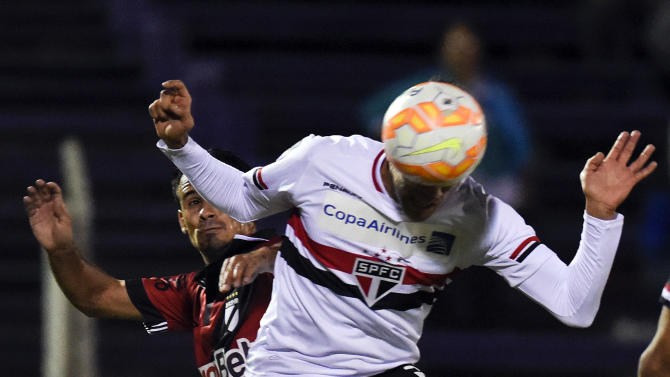 Ricky Centurion of Brazil's Sao Paulo FC, right, heads to score his team second goal, as Joaquin Pereira of Uruguay's Danubio attempts to stop him during a Copa Libertadores soccer game in Montevideo, Uruguay, Wednesday, April 15, 2015. Sao Paulo won the match 2-1. (AP Photo/Matilde Campodonico)