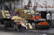 A vendor stands next to his fruit stall as he waits for customers near a mosque in Cairo March 11, 2013. The Egyptian pound has lost more than 8 percent of its value against the U.S. dollar since the end of December as concern deepens about the state of the economy, which is being undermined by political instability and rioting. Annual consumer inflation in Egyptian cities leapt to 8.2 percent in February from 6.3 percent in January, reaching the highest level since May last year. Food and drink prices rose 9.3 percent year-on-year last month. REUTERS/Amr Abdallah Dalsh