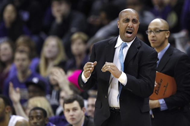 Washington coach Lorenzo Romar reacts to a play against Southern California during the first half of an NCAA college basketball game, Saturday, March 8, 2014, in Seattle. Washington won 82-75