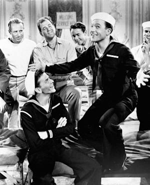 "FILE - This 1950 file photo originally released by MGM shows Gene Kelly, right, and Frank Sinatra in a scene from ""On the Town."" The lead producers behind the 1940s song-and-dance Broadway revival of ""On the Town"" are offering accredited folk an opportunity to invest in the production for as little as $10,000. ""On the Town,"" which was last on Broadway in 1998, features the songs ""New York, New York,"" ""I Can Cook Too,"" ""Lonely Town,"" and ""Some Other Time."" (AP Photo, File)"