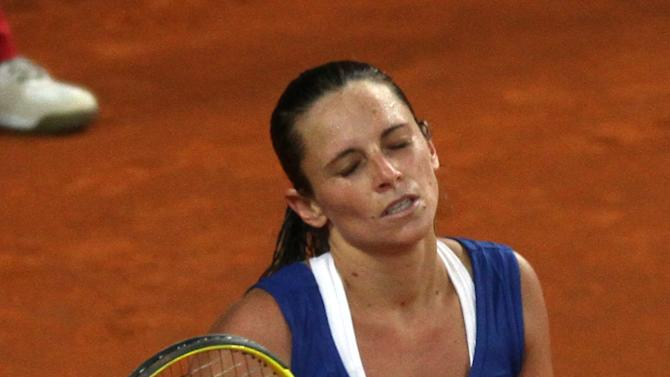 Italy's Roberta Vinci reacts after losing against United States' Varvara Lepchenko at the end of a World Group first round Fed Cup tennis match at the 105 stadium in Rimini, Saturday, Feb. 9, 2013. Lepchenko won 2-6, 6-4, 7-5. (AP Photo/Felice Calabro')