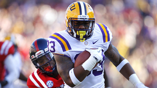 LSU running back Jeremy Hill (33) rushes past Mississippi defensive back Trae Elston (7) on a 27-yard touchdown carry during the first half of their NCAA college football game, Saturday, Nov. 17, 2012, in Baton Rouge, La. (AP Photo/Gerald Herbert)