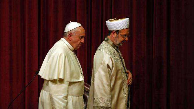 Pope Francis and Gormez, head of Turkey's Religious Affairs Directorate, leave after their meeting in Ankara