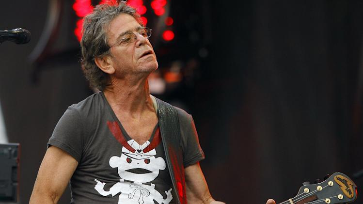 FILE - In this Sunday, Aug. 9, 2009 file photo, Lou Reed performs at the Lollapalooza music festival, in Chicago. The rocker's life was decidedly unconventional, but he wanted his estate used for a very traditional purpose: to benefit his wife and other relatives. Reed's will was filed Monday, Nov. 4, 2013, in a New York City court. (AP Photo/John Smierciak, File)