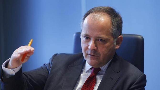 uCoeure, executive board member of the ECB, speaks during an interview with Reuters in Frankfurt