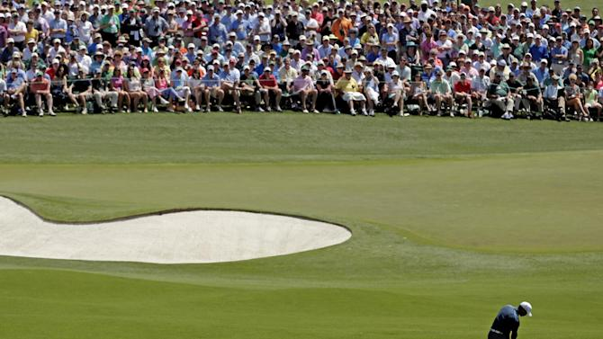 Tiger Woods hits off the second fairway during the third round of the Masters golf tournament Saturday, April 13, 2013, in Augusta, Ga. (AP Photo/Charlie Riedel)