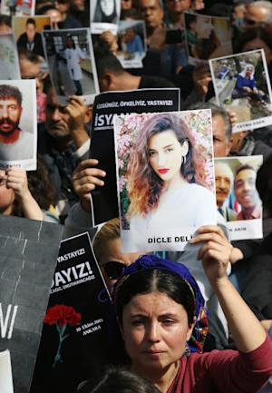 Demonstrators hold portraits of people killed by the …