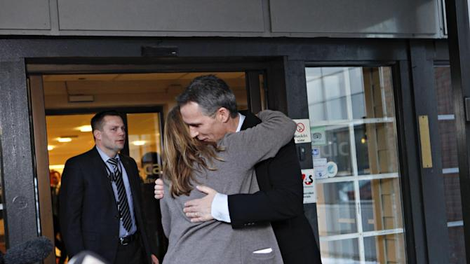 Norway's Prime Minister Jens Stoltenberg is embraced by Executive Vice President in Statoil, Margrethe Oevrum, Saturday Jan. 19,  2013, after his visit at the drop-in center in Bergen for relatives of the Statoil-employees taken hostage in Algeria. In a bloody finale on Saturday, Algerian special forces stormed a natural gas complex in the Sahara desert to end a four-day standoff with Islamic extremists that left at least 19 hostages and 29 militants dead. With few details emerging from the remote site, it was unclear whether anyone was rescued in the final operation. (AP Photo / Anette Karlsen, NTB scanpix) NORWAY OUT