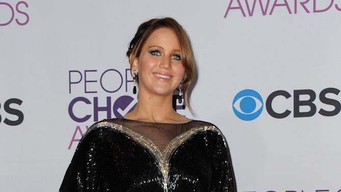 Jennifer Lawrence, winner of the award for favorite movie actress, poses backstage at the People's Choice Awards at the Nokia Theatre on Wednesday Jan. 9, 2013, in Los Angeles. (Photo by Jordan Strauss/Invision/AP)
