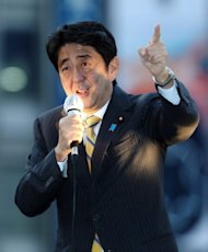 Former Prime Minister Shinzo Abe, pictured here on September 25, won a party election on Wednesday to make him leader of Japan&#39;s main opposition group, a position that may put him in line to become premier at the next election