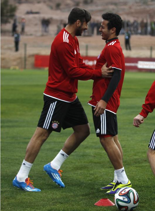 Bayern Munich's Thiago Alcantara smiles with teammate Jan Kirchhoff during a final training session ahead of their Club World Cup soccer match in Agadir