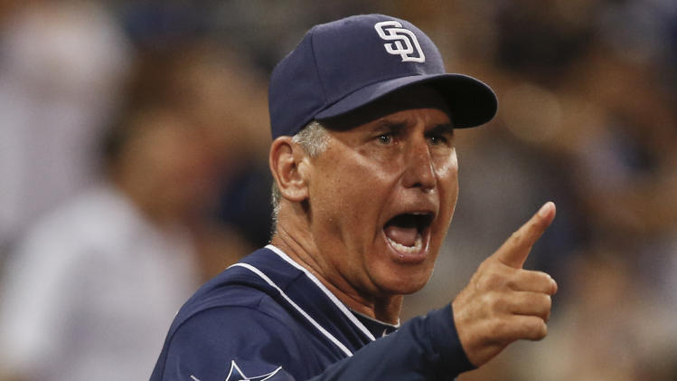 San Diego Padres manager Bud Black screams at first base umpire Clint Fagan after an appeal on checked swing was against the padres in the tenth inning of a baseball game Saturday, Aug. 30, 2014, in San Diego. Black was ejected. (AP Photo/Lenny Ignelzi)