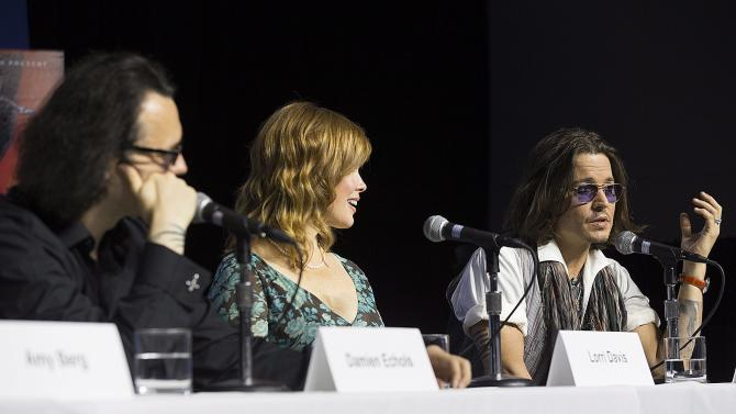 """Actor Johnny Depp, right, speaks at the press conference for documentary """"West of Memphis"""" at the 2012 Toronto International Film Festival in Toronto on Saturday, Sept. 8, 2012. (AP Photo/The Canadian Press, Michelle Siu)"""