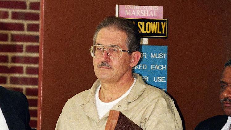 Former CIA agent Aldrich Ames leaves federal court after pleading guilty to espionage and tax evasion conspiracy charges in Alexandria, Va., USA, in this photo dated Thursday, April 28,1994. Aldrich, the highest ranking CIA employee ever caught spying, was sentenced to life in prison. As a CIA officer in Turkey, Ames worked to turn Russians against their government, but in 1985, he switched sides himself and offered his services to the Soviets and continued working for the Russians after the Cold War, passing dozens of names of people spying for the U.S. to his Russian masters who executed 10 of them. On Tuesday May 14, 2013, Russian security services announced they had detained a U.S. diplomat who they claim is a CIA official for allegedly trying to recruit a Russian agent. (AP Photo/Wilfredo Lee)