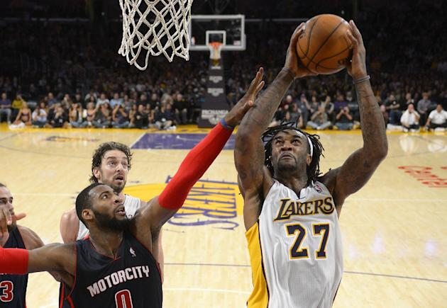 Los Angeles Lakers center Jordan Hill, right, puts up a shot as Detroit Pistons center Andre Drummond, lower left, defends while center Pau Gasol, of Spain, looks on during the second half of an NBA b