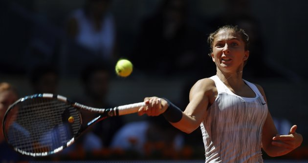 Errani of Italy returns the ball to Williams of the U.S. during their women's singles semi-final match at the Madrid Open tennis tournament