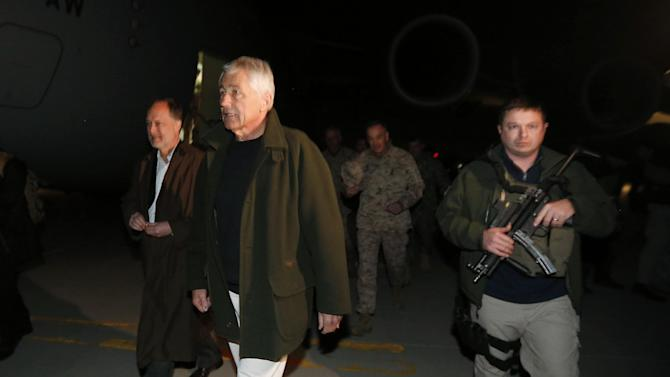 Defense Secretary Chuck Hagel walks with U.S. Ambassador to Afghanistan James Cunningham, left, and Gen. Joseph Dunford, center, Commander of the International Security Force, upon Hagel's arrival in Kabul, Afghanistan, Friday, March 8, 2013. Hagel arrived in Afghanistan Friday for his first visit as Pentagon chief, saying that there are plenty of challenges ahead as NATO hands over the country's security to the Afghans.  (AP Photo/Jason Reed, Pool)