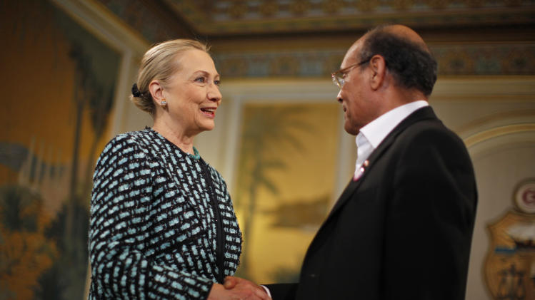 U.S. Secretary of State Hillary Rodham Clinton, left, meets with Tunisia's President Moncef Marzouk  at the Presidential Palace in Carthage, Tunisia, Saturday Feb. 25, 2012. (AP Photo/Jason Reed, Pool)