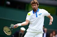 Former world number one Juan Carlos Ferrero, seen here in June 2012, will retire from professional tennis in October after a 14-year career in which he won 16 tour titles