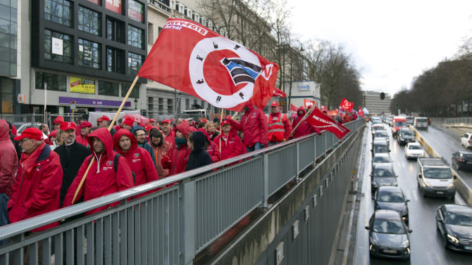 Demonstrators and trade union activists hold flags and chant slogans during a demonstration against Belgian austerity reforms in Brussels on Monday, March 30, 2015. Like a series of strike actions late last year, the protesters targeted measures by the business-friendly government of Prime Minister Charles Michel to cut into employees' income, extend working time and restrict social services. (AP Photo/Virginia Mayo)