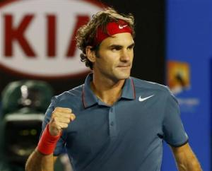 Roger Federer of Switzerland celebrates defeating Jo-Wilfried Tsonga of France during their men's singles match at the Australian Open 2014 tennis tournament in Melbourne