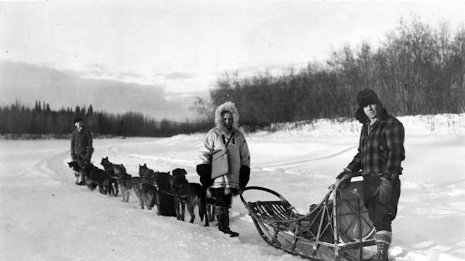 In this undated photo provided by the National Archives at College Park, William F. Arends, center, one of the more than 120,000 enumerators, returns to his dog sled after completing an enumeration near Fairbanks, Alaska for the 1940 Census. At right is musher Mike Agababa. Veiled in secrecy for 72 years because of privacy protections, the 1940 U.S. Census is the first historical federal decennial survey to be made available on the Internet initially rather than on microfilm. (AP Photo/U.S. Bureau of the Census, Dwight Hammack)