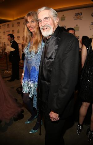 Martin Landau, right, arrives at the 24th Night of 100 Stars Oscars Viewing Gala at The Beverly Hills Hotel on Sunday, March 2, 2014 in Beverly Hills, Calif. (Photo by Annie I. Bang /Invision/AP)