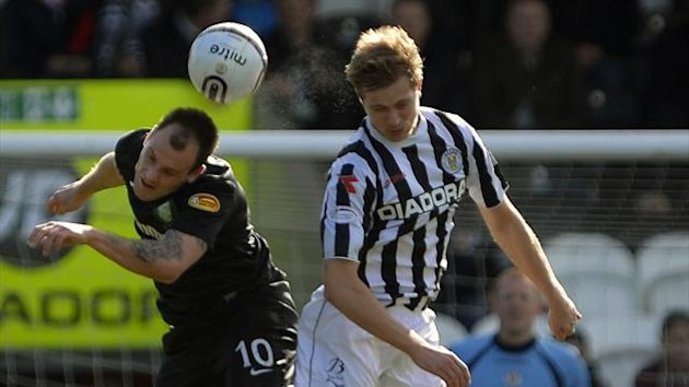 Celtic's Anthony Stokes (L) challenges St. Mirren's Marc McAusland during their Scottish Cup 6th round soccer match at St. Mirren Park Stadium in Paisley (Reuters)