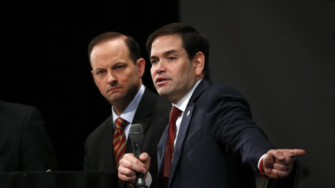 Republican presidential candidate, Sen. Marco Rubio, R-Fla., accompanied by South Carolina Attorney General Alan Wilson, speaks during a Faith and Family Presidential Forum at Bob Jones University, Friday, Feb. 12, 2016, in Greenville, S.C. (AP Photo/Paul Sancya)