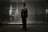 A paramilitary guard stands before the bars of a main gate to the No.1 Detention Center during a government guided tour in Beijing on October 25, 2012. China put to death a Filipina drug trafficker Wednesday, the Philippine foreign department said, after Beijing ignored Manila's request to spare her life