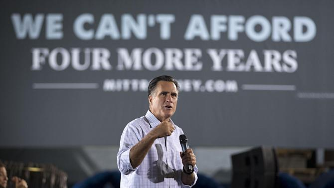 "FILE - In this Sept. 26, 2012, file photo Republican presidential candidate, former Massachusetts Gov. Mitt Romney, campaigns at American Spring Wire in Bedford Heights, Ohio. ""This election, in my opinion, comes down to a very dramatic choice between two different courses for America,"" Romney said at a same-day stop in Westerville. Polls are showing Americans are feeling better about the economy and President Barack Obama's leadership, causing serious problems for Romney five weeks before Election Day even with unemployment above 8 percent for a 43rd straight month. The polls also show Obama opening up leads over Romney in several key states. (AP Photo/ Evan Vucci, File)"