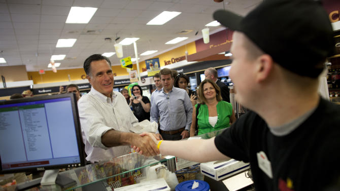 Republican presidential candidate, former Massachusetts Gov. Mitt Romney shakes hands during a stop at Wawa gas station in  in Quakertown, Pa., Saturday, June 16, 2012.  (AP Photo/Evan Vucci)