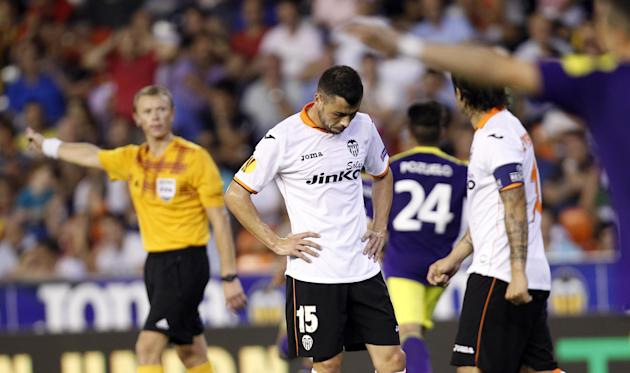 Valencia's Javi Fuego, looks towards the ground after his team conceded a goal against Swansea City during their  Europa  League Group A soccer match at the Mestalla stadium in Valencia, Spain, Thursd